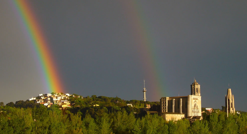 Girona, Spain, under a double rainbow
