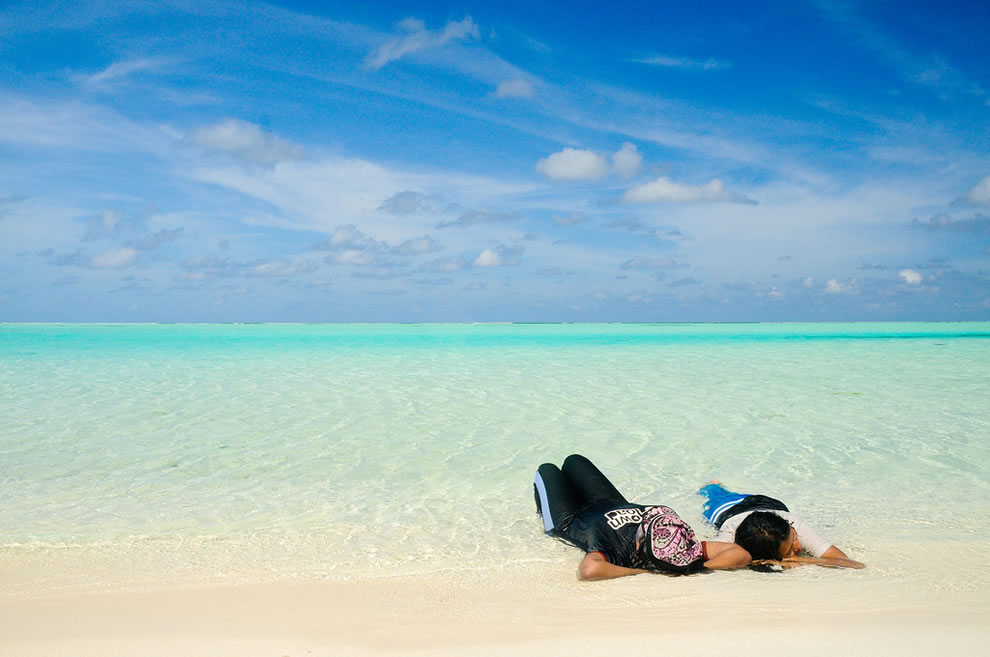 Kicking back in white sand and water of the Maldives