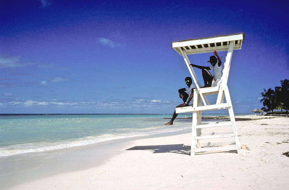 Lifeguards on the white sand beach in Jamaica