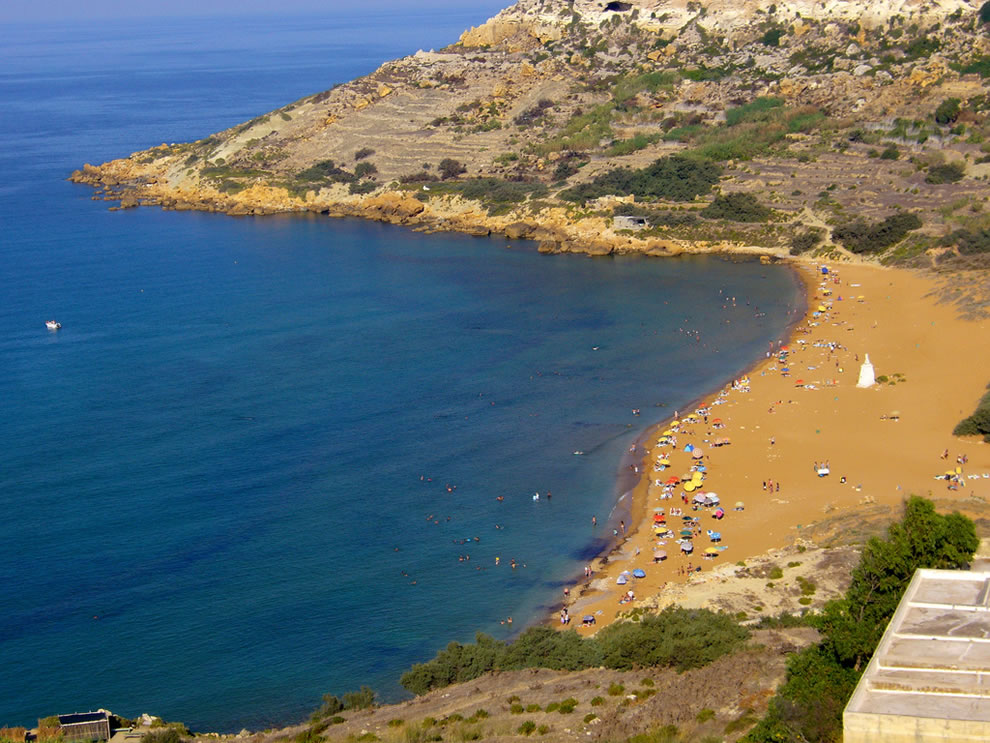 Ramla Bay beach has a golden-red hue due to a high iron content, called orange sand beach