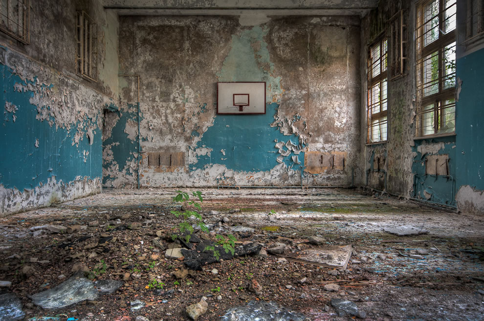 School's out, nature reclaiming an old school gym, beautiful decay