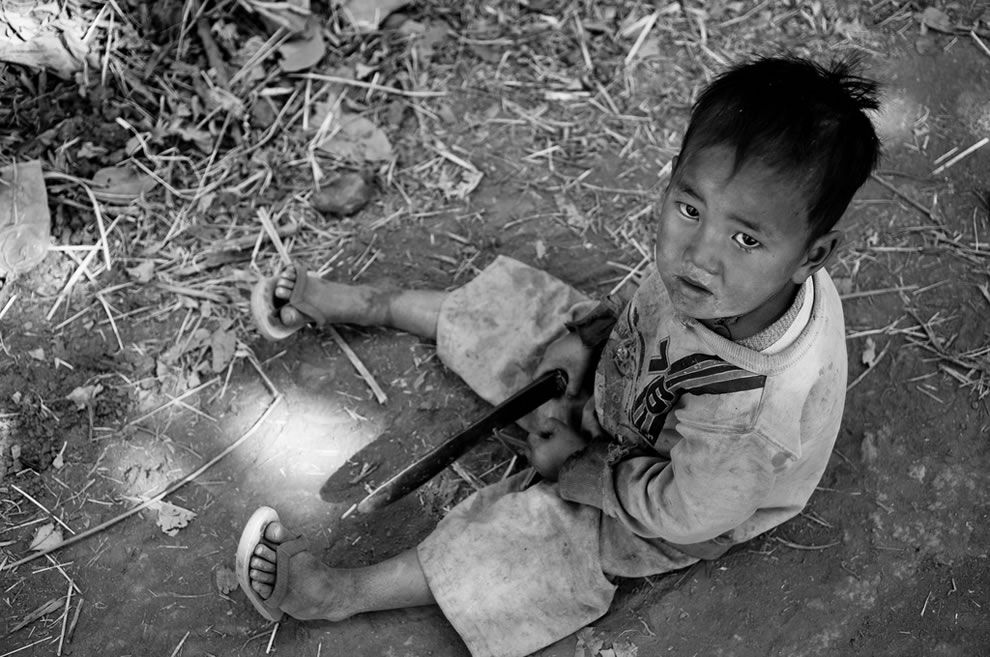 Boy playing with a knife