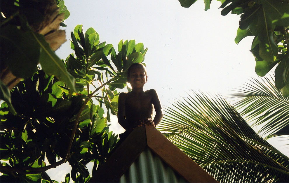 Boy on a roof in Lavena