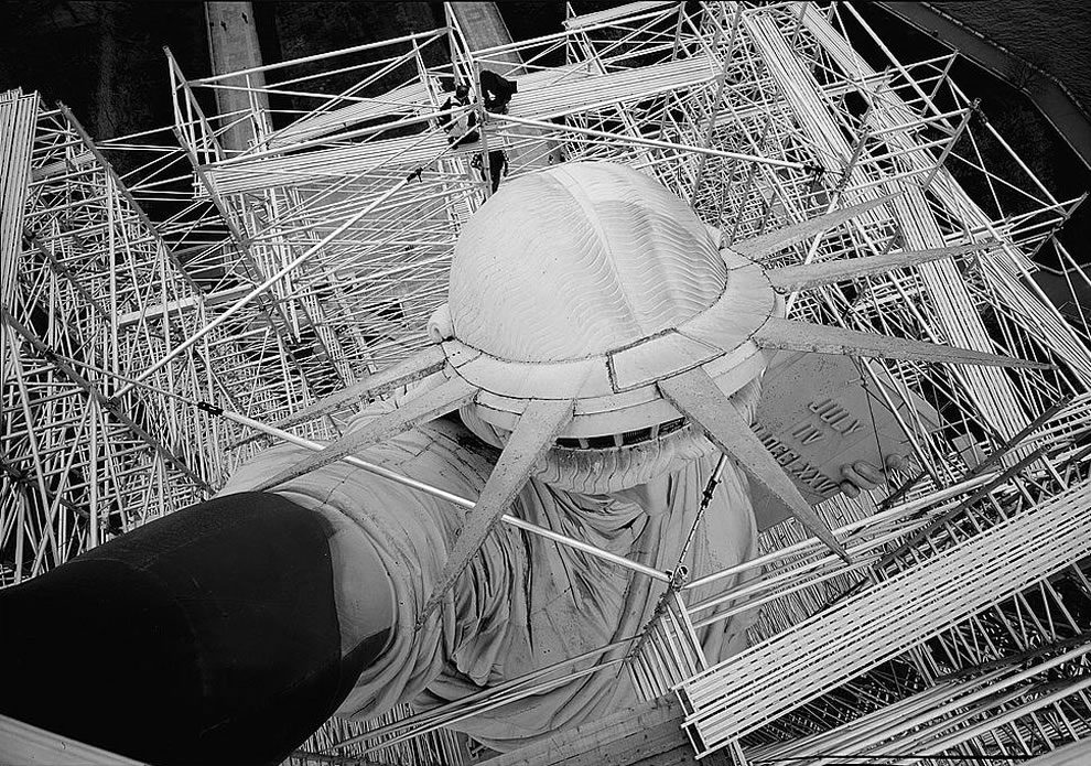 1984 view looking down on top of head showing body enclosed in scaffolding