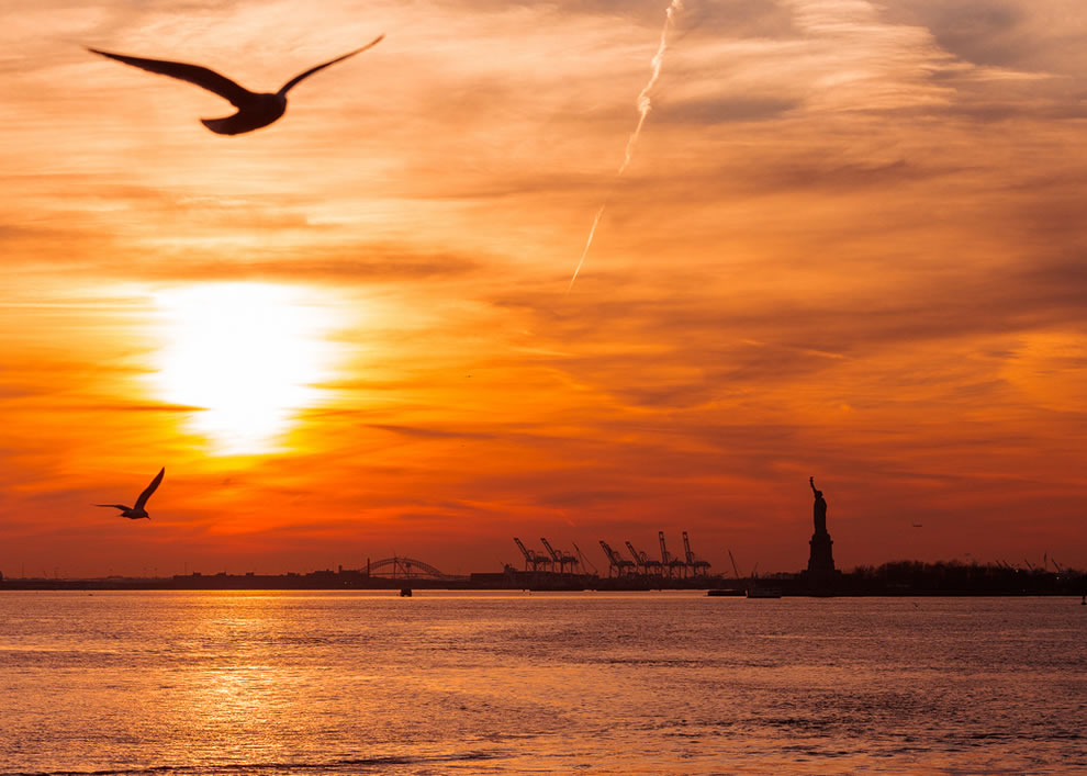 Birds, boats and Lady Liberty at Sunset