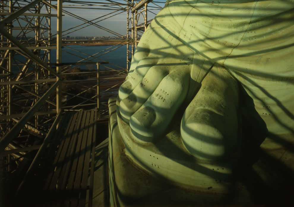 Close-up details of Lady Liberty's right foot showing missing rivets in 1984