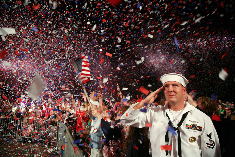 Sailor salutes as the American flag is presented on stage during the Boston Pops Fireworks Spectacular at the Charles River Esplanade, July 4th