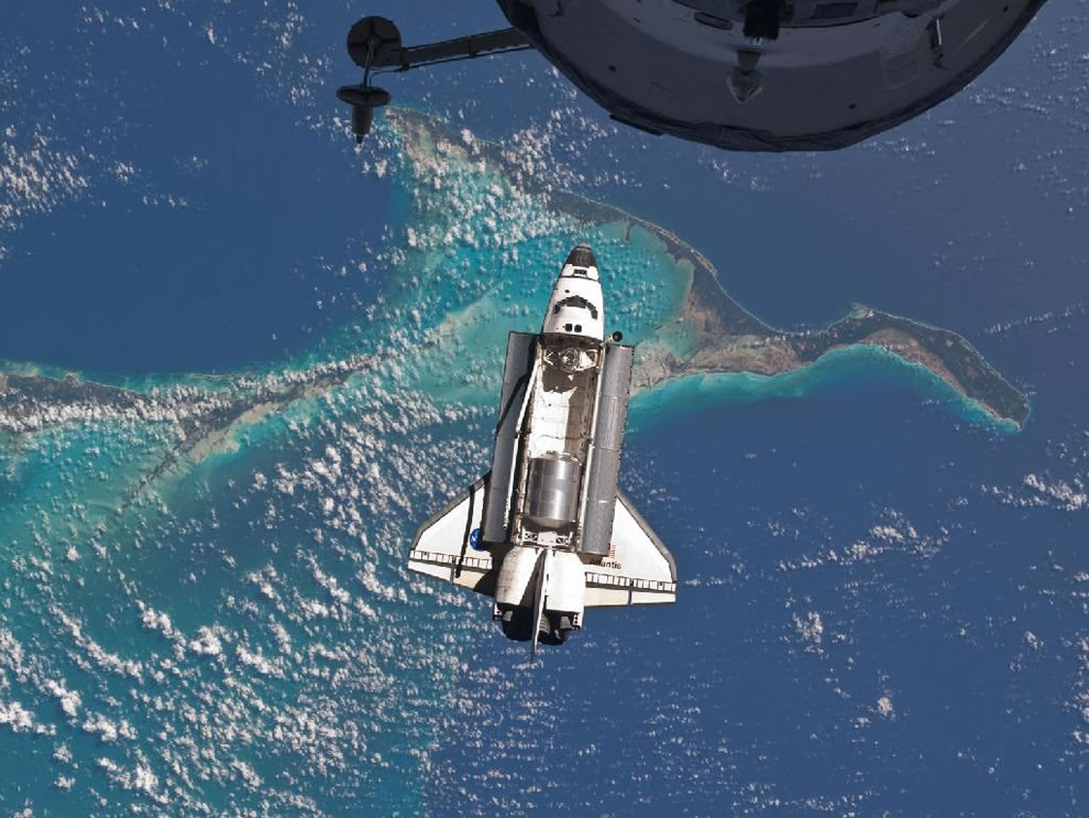 Space shuttle Atlantis is seen over the Bahamas prior to a perfect docking with the ISS on July 2011