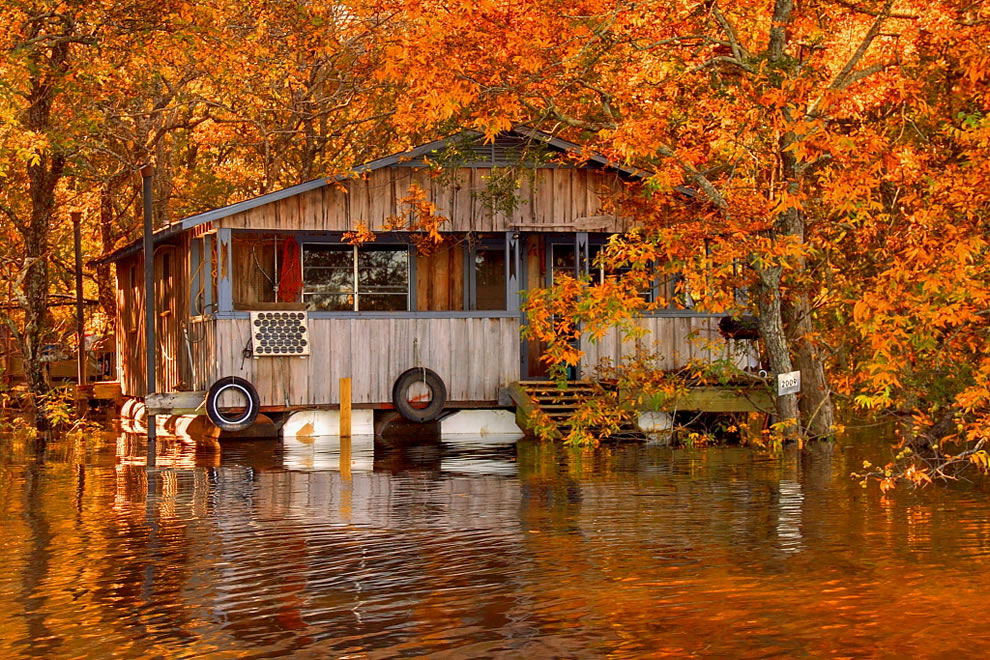 Fall foliage and floating camp on the Ouachita River in Louisiana