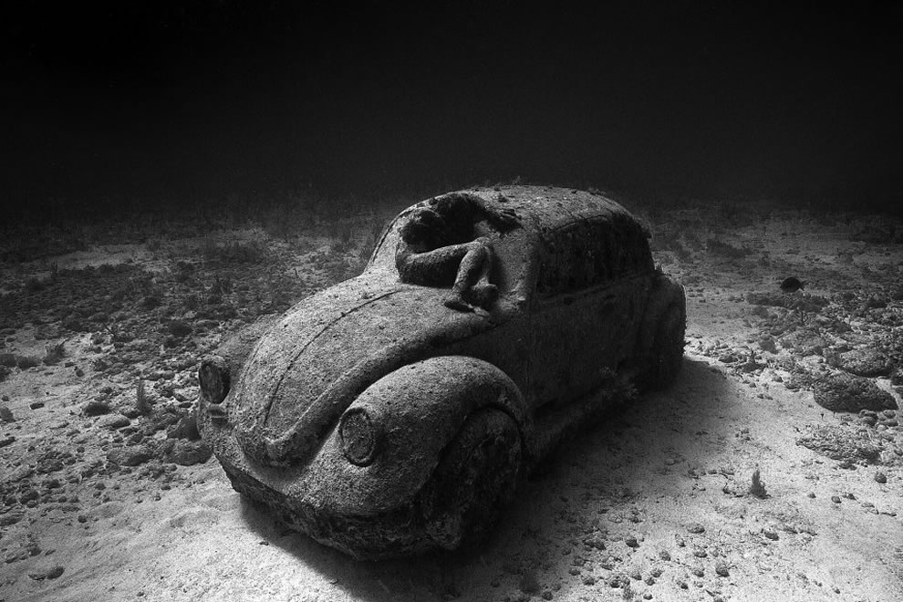 Jason deCaires Taylor's Anthropocene, man and car in black and white, MUSA collection