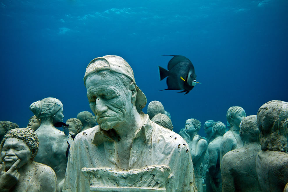The Silent Evolution - underwater sculpture off the coast of Cancun, Mexico