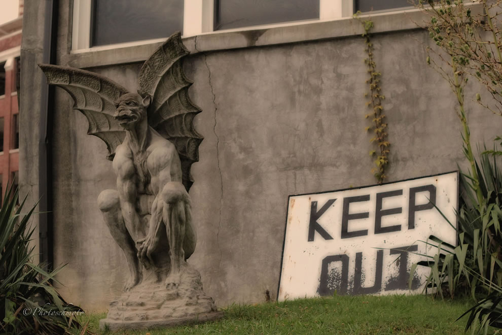 Waverly Hills gargoyle and KEEP OUT sign