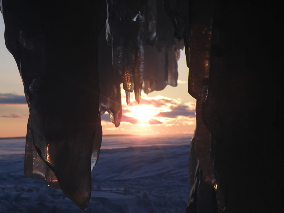 Setting sun outside ice cave