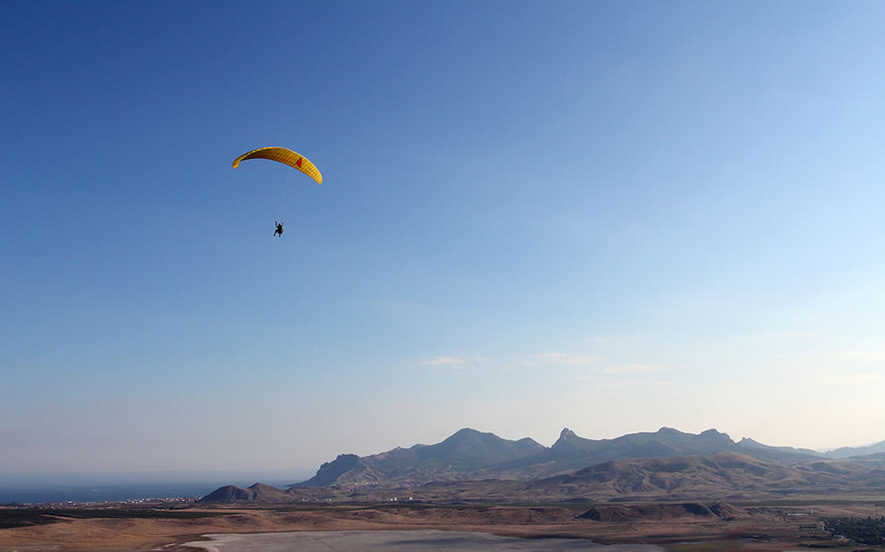 Parasailing over the amazing landscape of Koktebel, Crimea