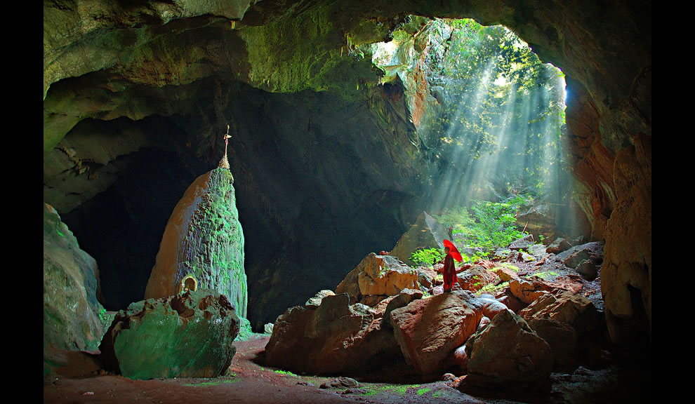 Myanmar cave and temple in Southeast Asia, sunlight shining on novice