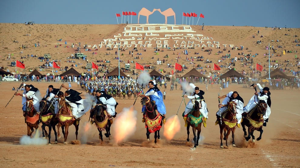 Sahrawi tribal men performing fantasia at the Tan-Tan (Moussem) Festival in Tan-Tan, Morocco