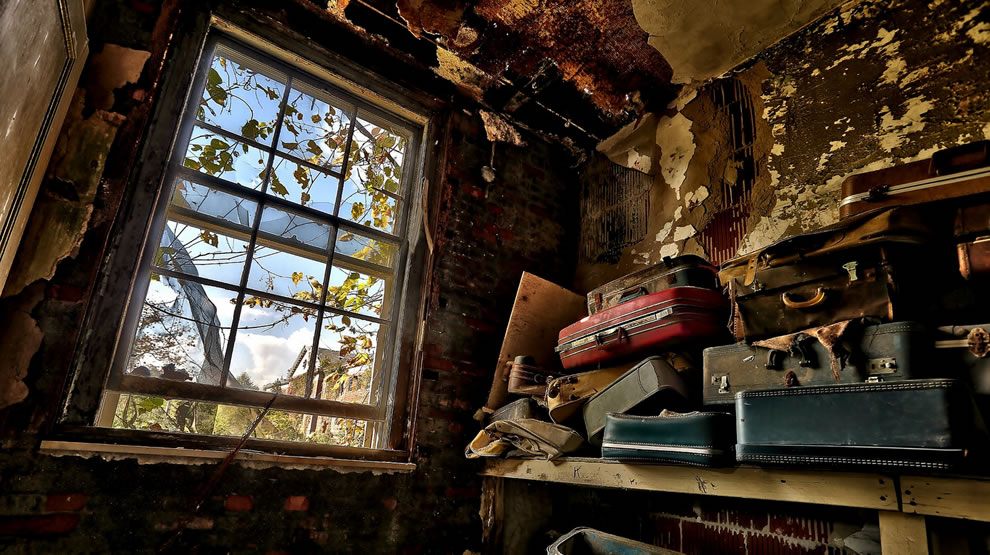 Left behind luggage at abandoned Forest Haven asylum