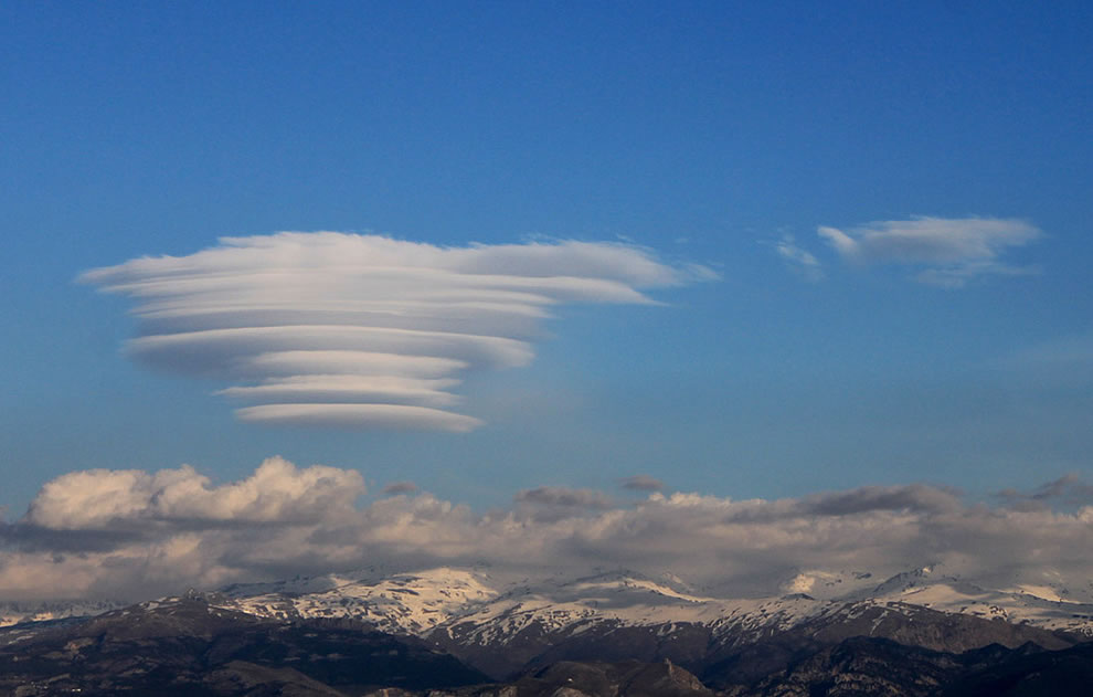 Lenticular cloud over the Sierra Nevada in Granada, Spain