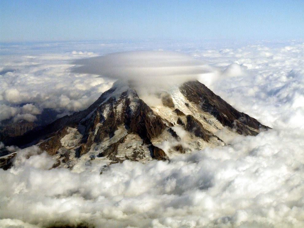 Mount Rainier pokes through the clouds