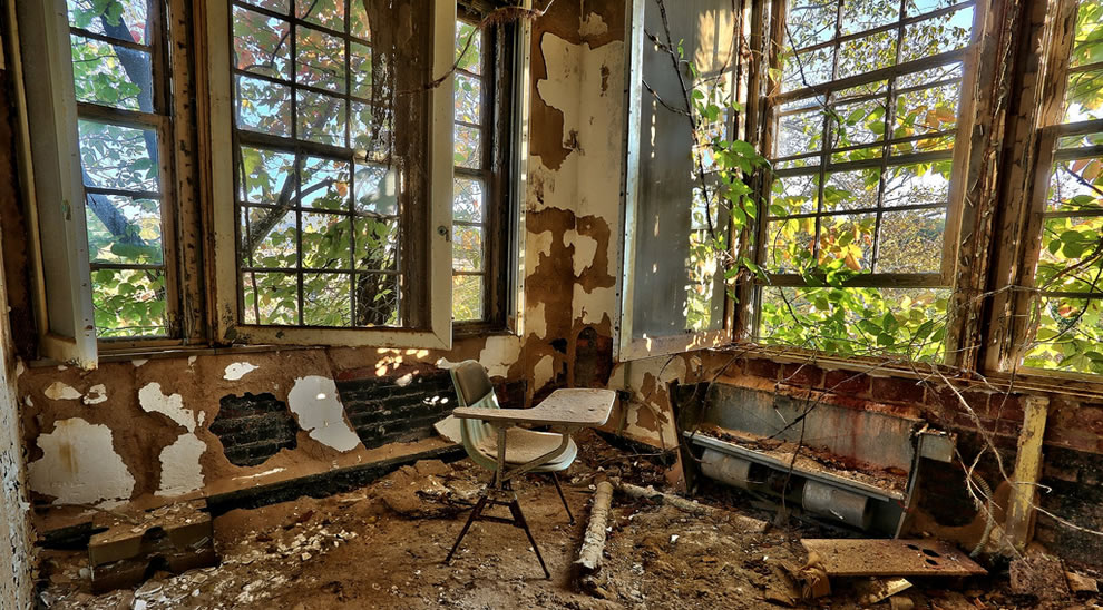 Nature trying to reclaim forgotten children asylum ruins