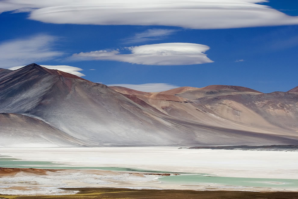 lenticular clouds over salt flat in the Atacama Desert in Chile