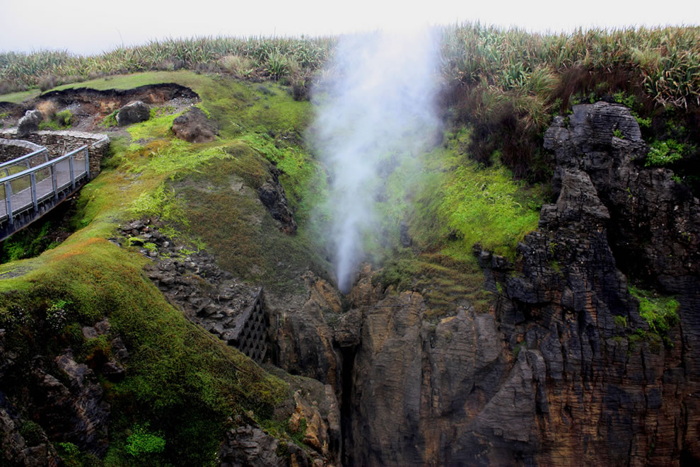Spouting blowhole on a stormy day at Punakaiki, New Zealand