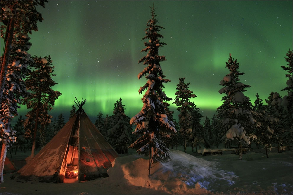 Aurora Borealis over tepee in Sweden