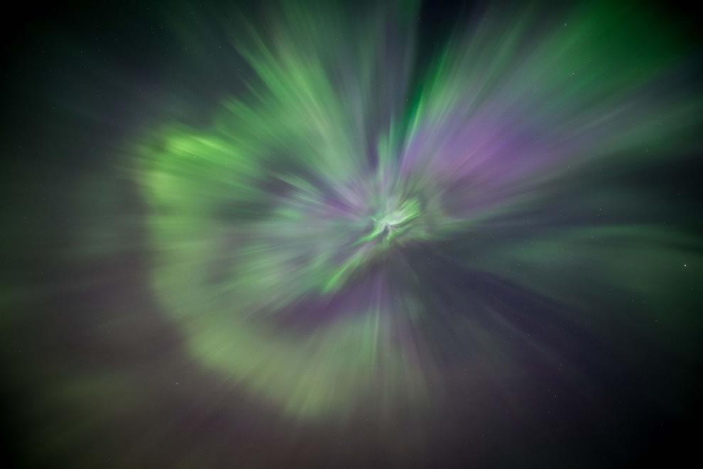 looking straight up at Aurora Burst in Alberta Canada