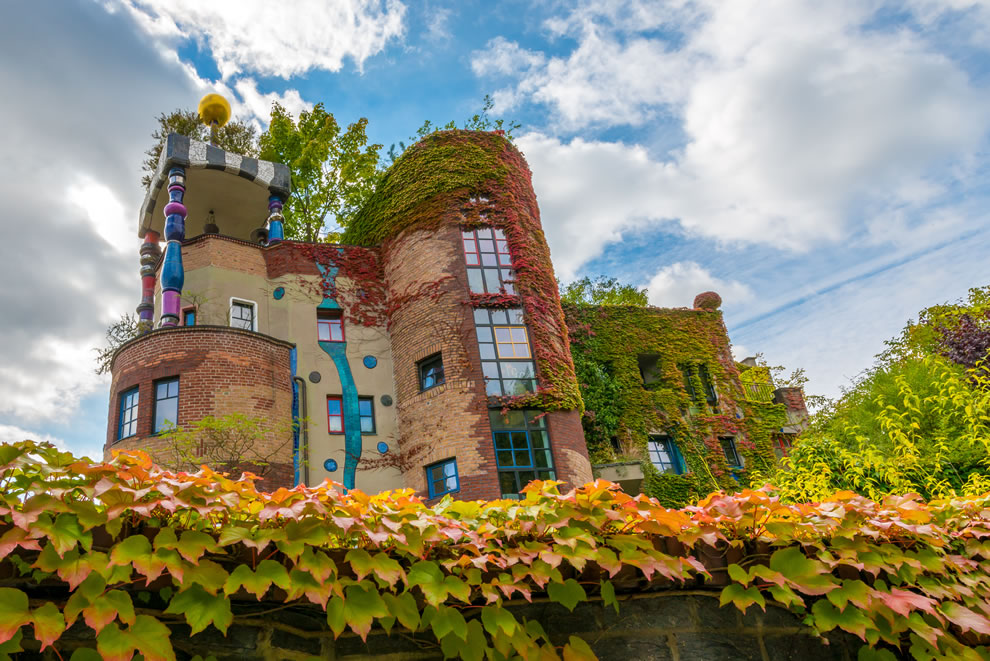 Autumn at residential building in Bad Soden, Germany designed by Friedensreich Hundertwasser