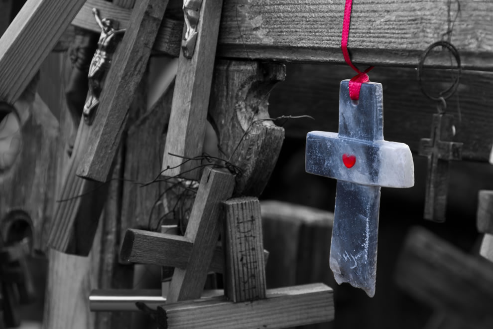 Cross with a red heart
