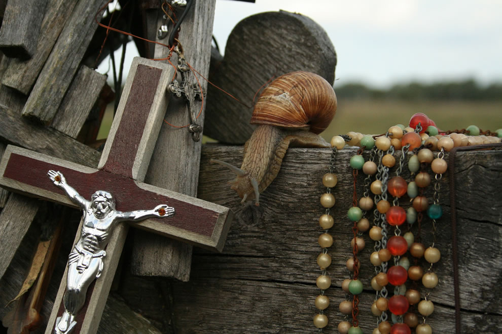 Crosses, beads, a snail