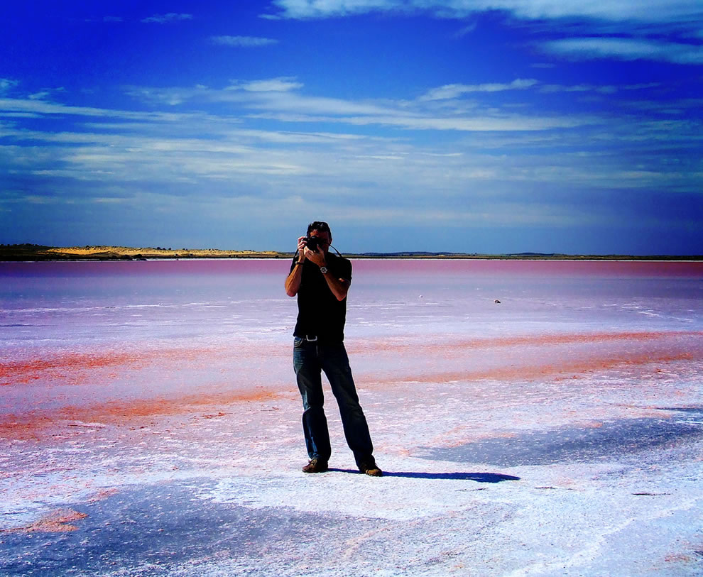 Photographer on the salt of pink lake