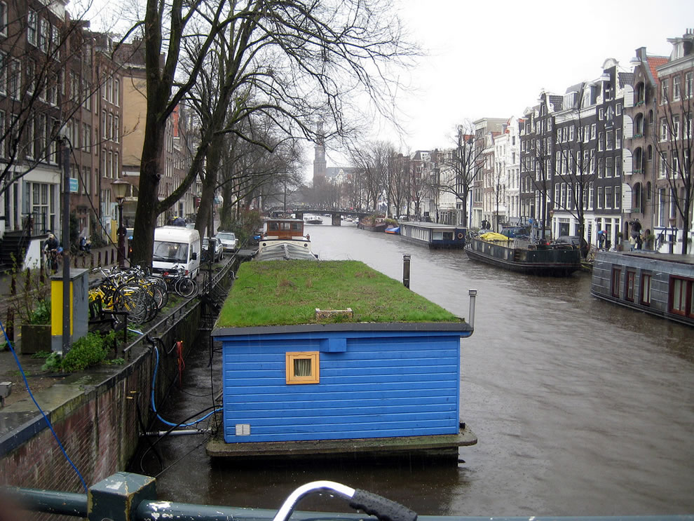 A sod roof on houseboat in a canal in Amsterdam