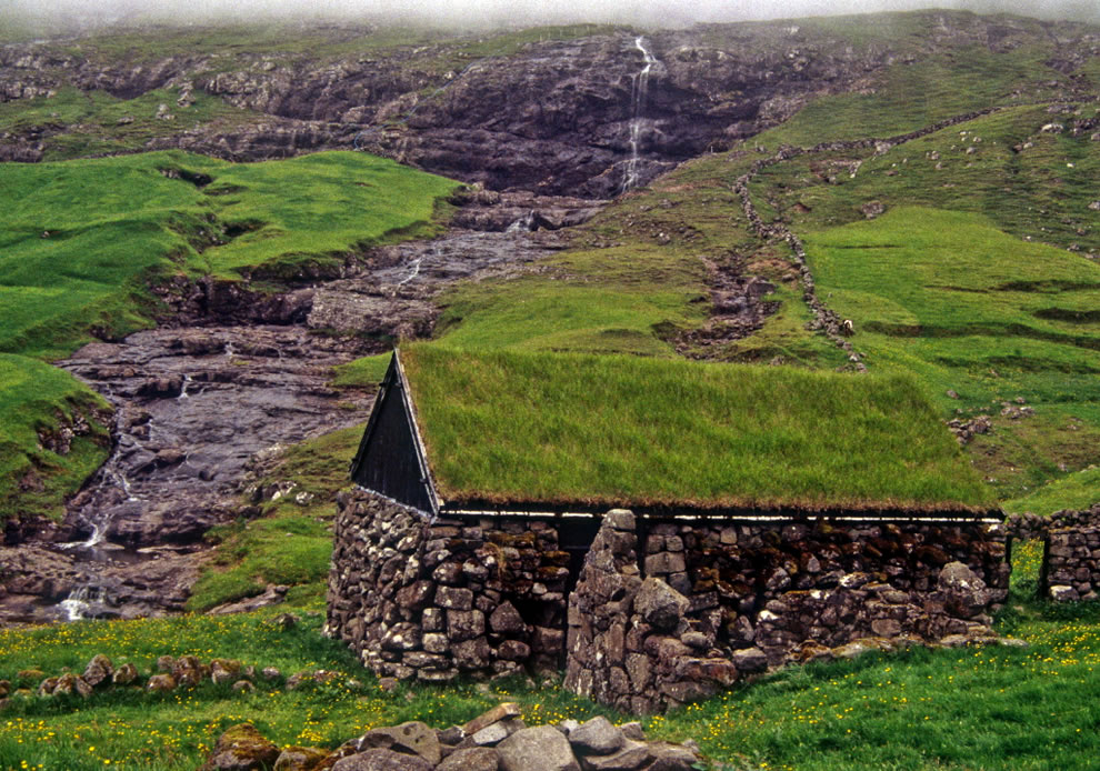 Faroese farmstead and waterfall