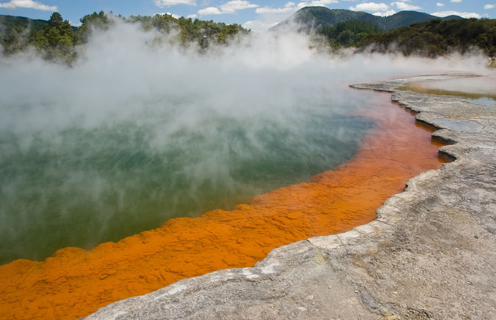 New Zealand's bubbly geothermal Champagne Pool at the Artist's Palette at the Wai-o-tapu Thermal Wonderland with arsenic orange colors
