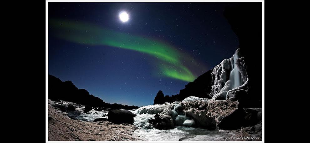 Moon-shimmering waterfall and Aurora Borealis