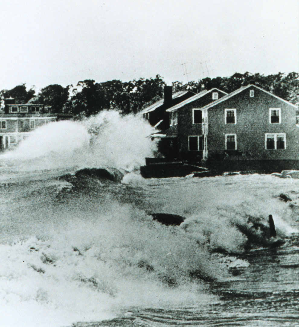 1954 - Hurricane Carol destroyed hundreds of summer cottages and homes Huge waves bound into beach front homes