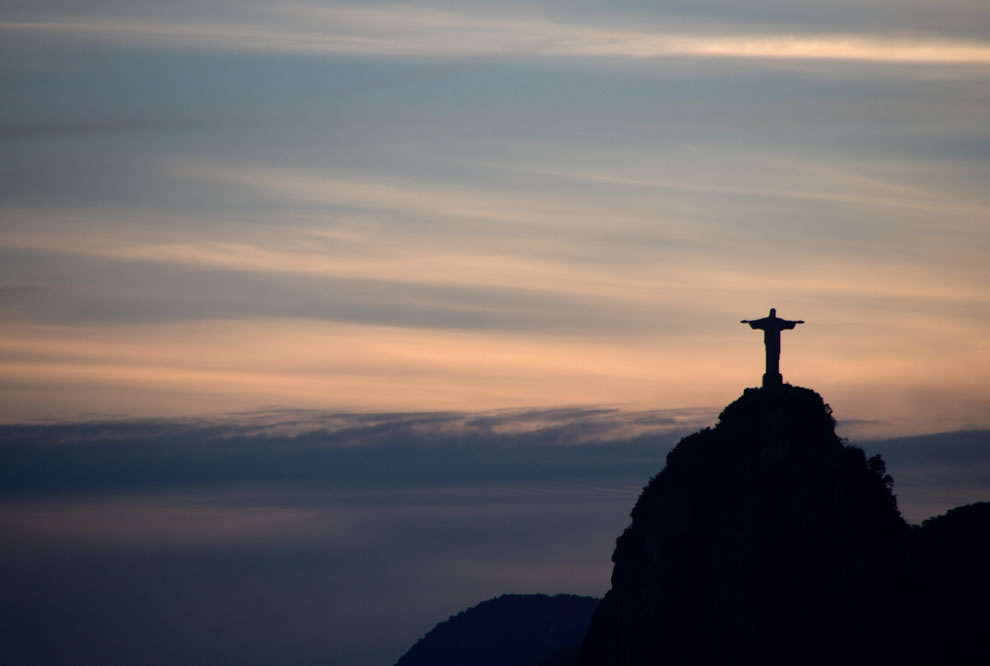 Christ Redeemer at sunset - The silhouette of Christ Redeemer in Rio de Janeiro