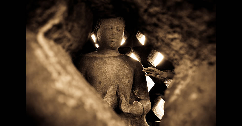 Hope at Borobudur temple, Java, Indonesia. Touching of Buddha gives people a hope to make their dreams real