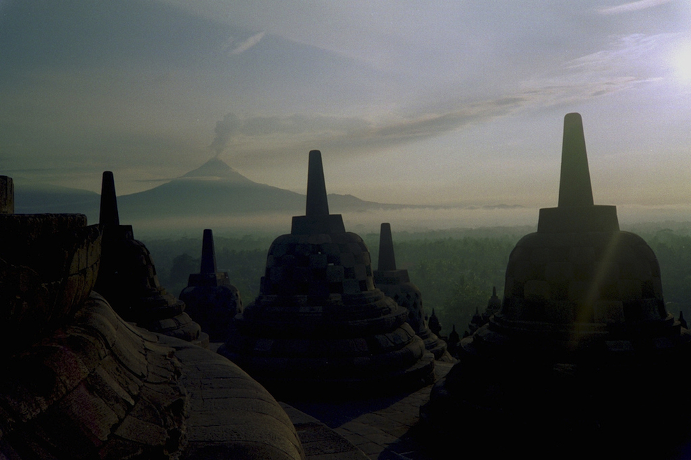 Mt. Merapi erupts from Borobudur horizon