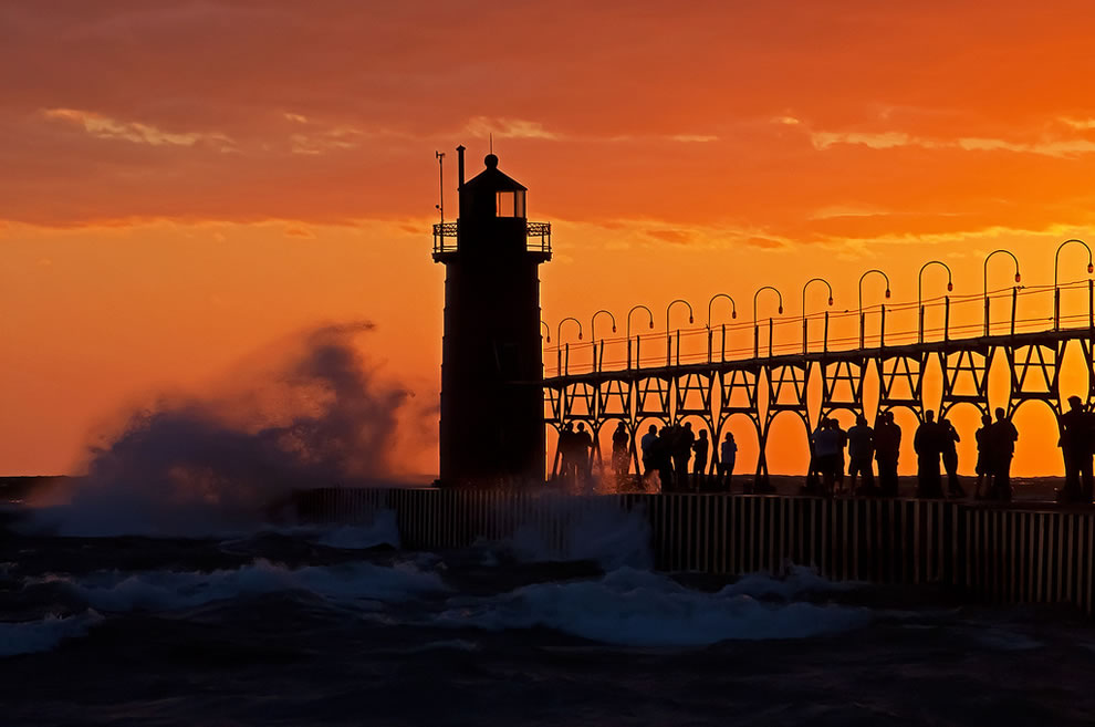 Gale force winds at South Haven, Michigan attract visitors to the lighthouse and pier, along with surfers and intrepid kayakers.