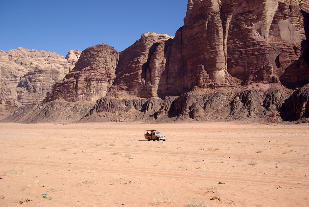 lonely riders in a truck at wadi rum