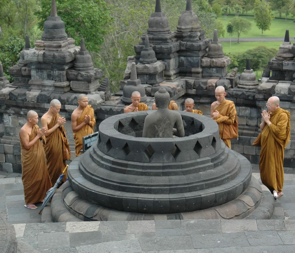 Buddhist monks praying at borobudur