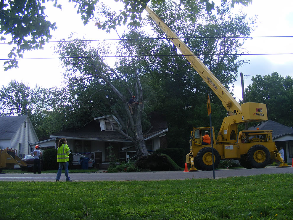 Help arrives for house with tree squashing it after storms in Boonville Indiana
