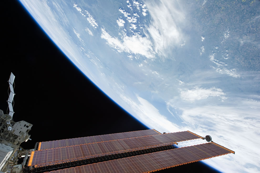 ISS Solar Array panels and a blue and white part of Earth