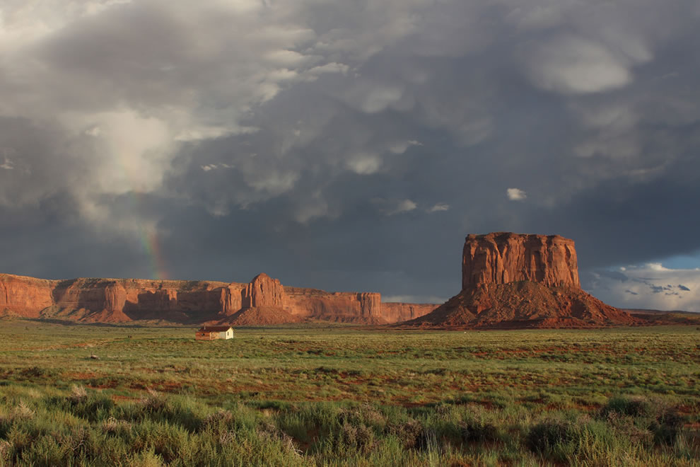 Storm, rainbow over Monument Valley