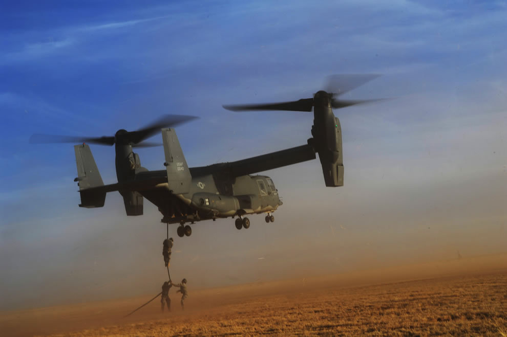 U.S. Army soldiers with Alpha Company, 4th Battalion, 10th Special Forces Group fast-rope from a CV-22 Osprey tiltrotor aircraft during exercise Emerald Warrior 2011