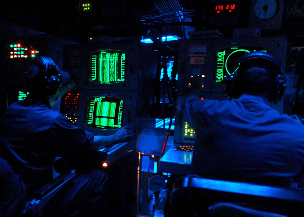 U.S. Navy sonar technicians aboard the guided-missile destroyer USS The Sullivans (DDG 68) monitor sonar equipment for marine mammals or submarine activity during the Southeastern Anti-Submarine Warfare Integrated Training Initiative in the Atlantic Ocean