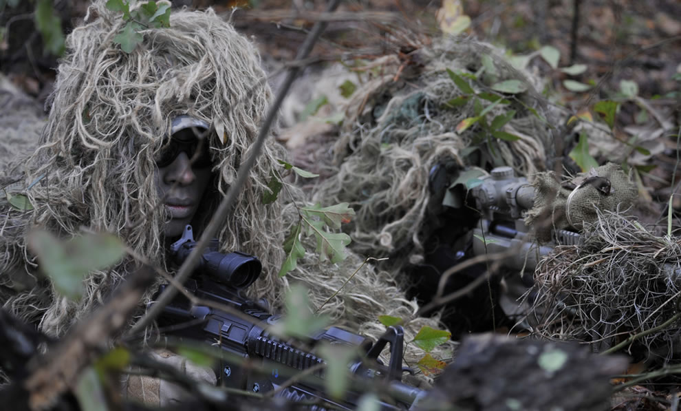 U.S. Air Force Senior Airman Antwone Dunlap, left, a sniper team spotter, and Airman 1st Class Ricky Smith, a sniper team shooter, both assigned to the 822nd Base Defense Squadron, prepare to provide cover fire for Airman during an urban operations training demonstration at Moody Air   Force Base