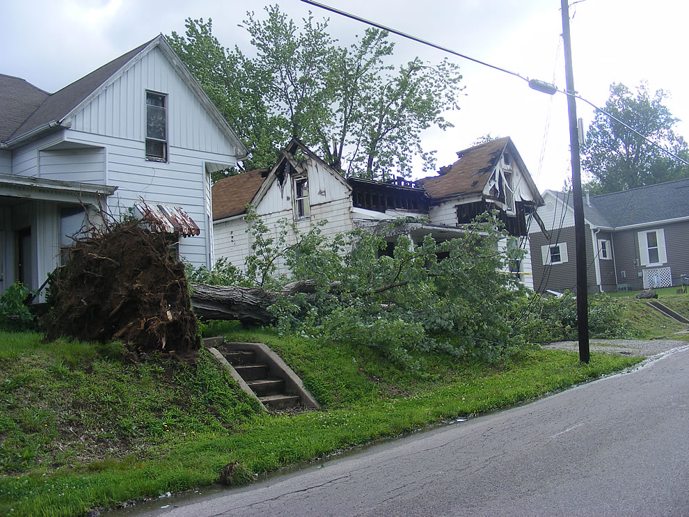tree rips out by the roots during storm - then house next door catches fire - Indiana